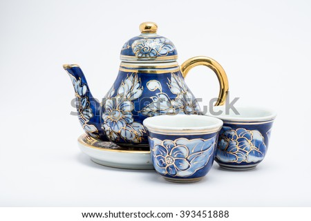 ceramic tea pot and cup on white background