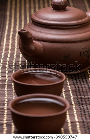 ceramic teapot and two cups for the tea ceremony on the bamboo napkin
