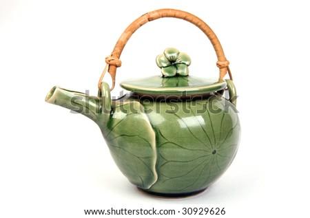 Ceramic teapot on white background. - stock photo