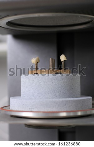 ceramic teeth ready for baking in the oven - stock photo
