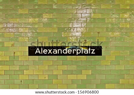 Ceramic tiled wall with Alexanderplatz sign at U-ban Alexanderplatz station in Berlin, Germany. - stock photo