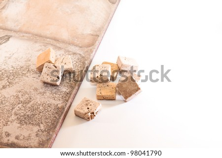 Ceramic tiles and mosaics made of stone on a white background - stock photo