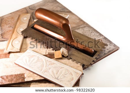 Ceramic tiles and tools for applying adhesive - stock photo