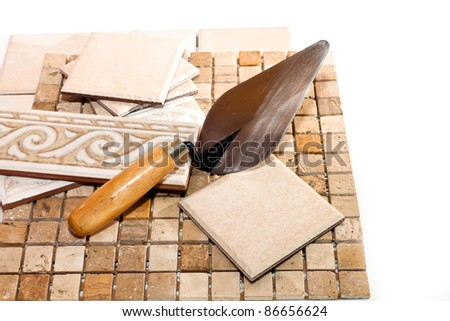 ceramic tiles and trowel for repairs