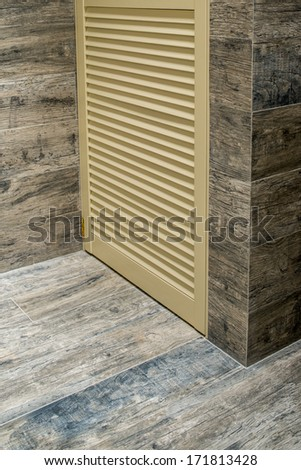 ceramic tiles and wooden furniture - stock photo