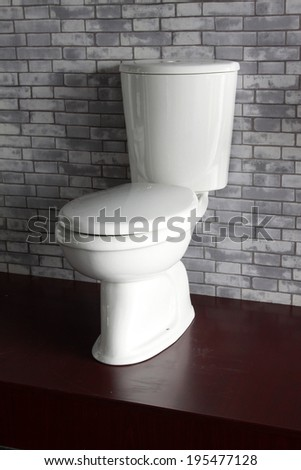 Ceramic toilet features in a factory, closeup of photo
