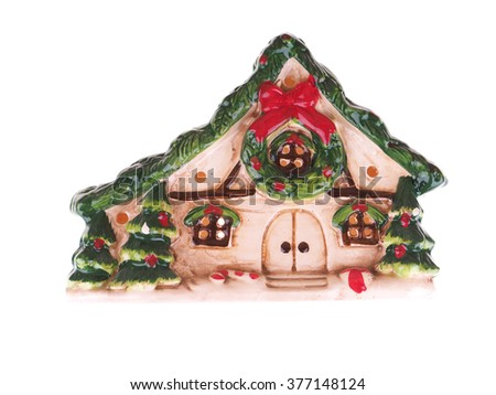 ceramic toy house on a white background - stock photo