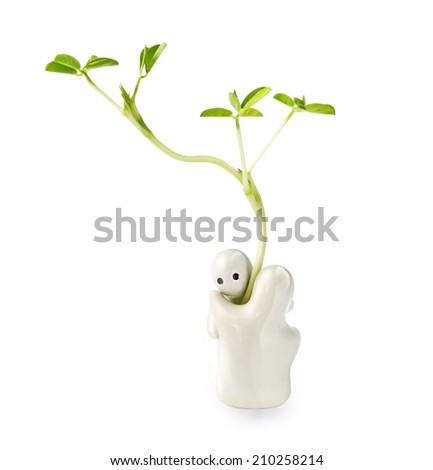 Ceramic toy hug the plant concept on white background - stock photo