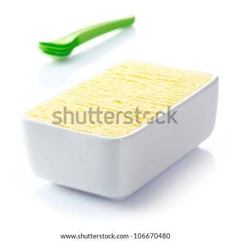 Ceramic tub filled with textured delicious frozen vanilla icecream ready to be served for dessert at a summertime meal - stock photo
