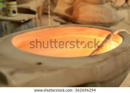 Ceramic unpainted clay idol, closeup of photo - stock photo