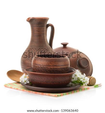 ceramic utensils isolated on white background - stock photo