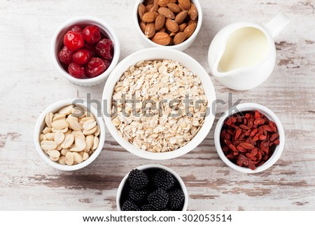 cereal and various delicious ingredients for breakfast, top view, horizontal - stock photo