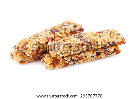 Cereal bars with different nuts and seeds isolated on white background. - stock photo