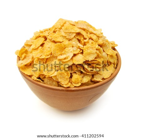Cereal flakes in wooden bowl on white background - stock photo