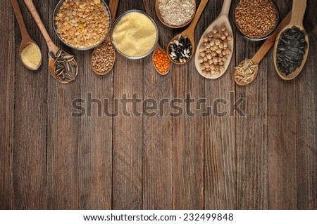 Cereal grains , seeds, beans on wooden background. - stock photo