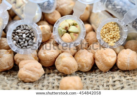 cereal in tube on brown burlap - stock photo