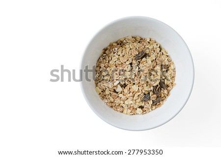 cereal mix with prunes and raisins in white dish - stock photo