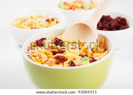 Cereal muesli breakfast with dried fruit over white background