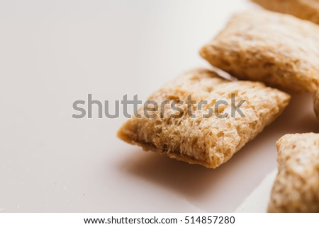 cereal pillows with chocolate filling on white background.