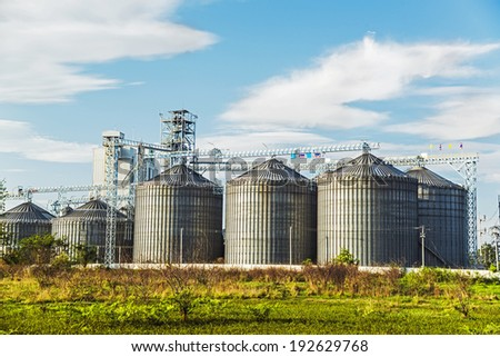 Cereal silos under the blue sky. - stock photo