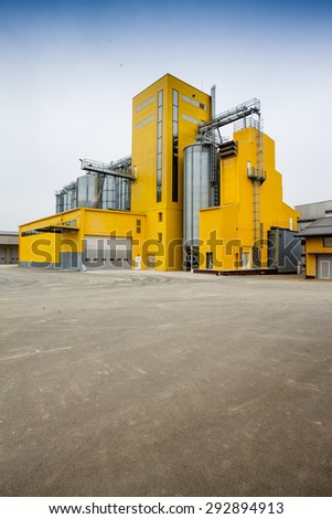 Cereal silos with a yellow building
