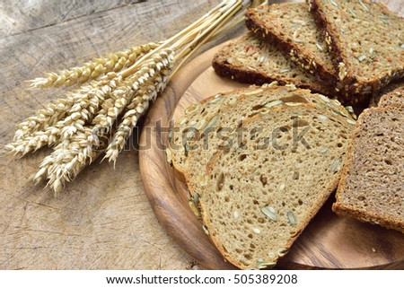 Cereal, wheat and bread on a wooden table