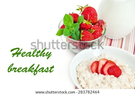 Cereal with fresh strawberry and milk, selective focus, with place for text