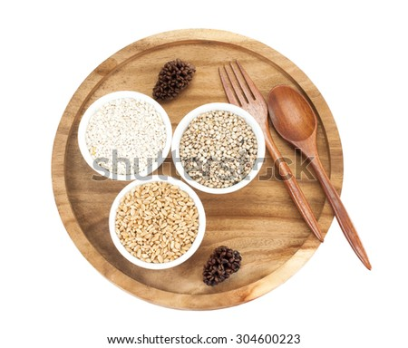 Cereals and grains in ceramic on a wooden tray.on white background.