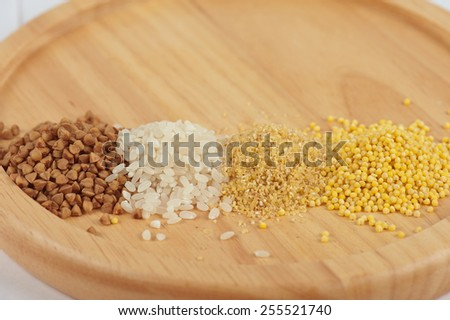 Cereals - buckwheat rice millet and wheat groats - stock photo