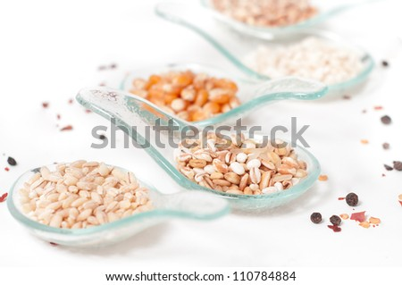 Cereals _ Grains on glass spoons - stock photo