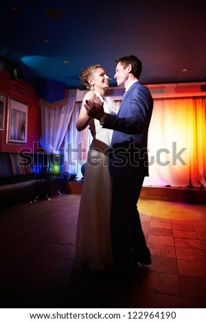 Ceremonial dance bride and groom on banquet - stock photo