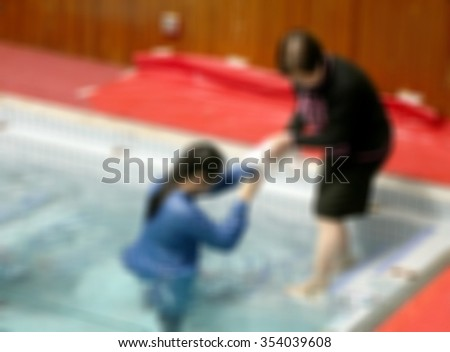 Ceremony of baptism blurred background. person christ babies priest baptism religion mature emotions child candle water indoors image christianity new Birth victory death New life pond dip Dead to Sin - stock photo