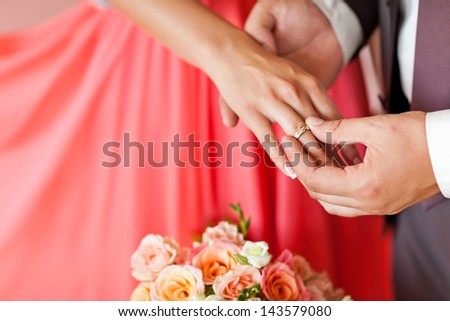 Ceremony. Wear rings. The bride and groom. - stock photo