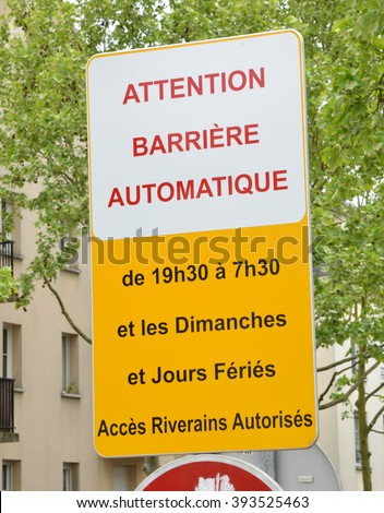 Cergy, France - april 5 2015 : a sign of automatic gate