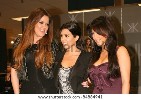 "CERRITOS, CA - SEPTEMBER 18: The Kardashian sisters arrive at the Sears in Cerritos Mall for the launch of their brand new clothing line, ""Kardashian Kollection"" in Cerritos, CA on September 18, 2011. - stock photo"