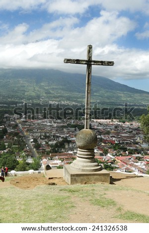 Cerro de la Cruz cross  overlooking Antigua, Guatemala on cloudy day, July 2012