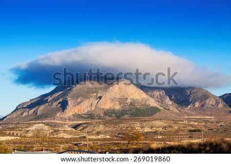 Cerro Jabalcon mount and Lenticular cloud near Baza.  Spain  - stock photo