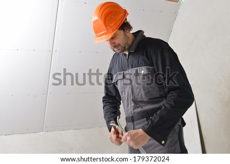 Certified electrician worker - stock photo