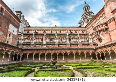 Certosa di Pavia, Italy - April 19, 2015: Picture of the church inside the large garden. The winter season does not allow to see the beautiful colors of the meadows and flowers.
