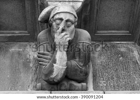 Cervera (Catalunya, Spain): historic palace with grotesque statues. Black and white
