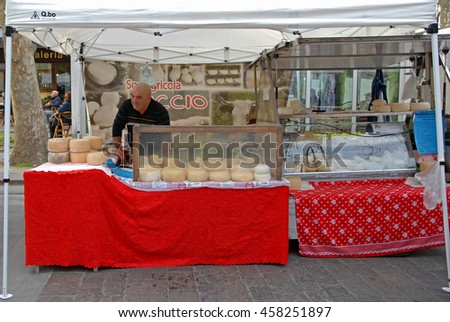 CERVIA, ITALY-MARCH 27, 2016: cheese stand at the village Sunday market. This market is very popular and attract thousands of tourists.