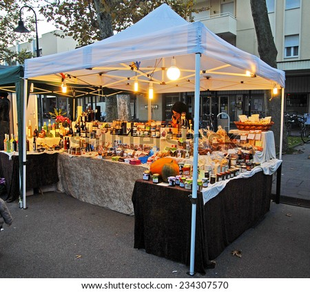 CERVIA, ITALY- NOVEMBER 2, 2014: typical stand at the Sunday open market. The market is very popular and attract thousand of people. - stock photo