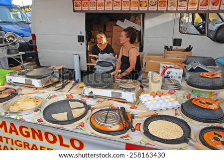 CERVIA, ITALY-SEPTEMBER 21, 2014: cooking plates  stand at the annual International food outdoor market. This market is very popular and attract thousands of tourists. - stock photo