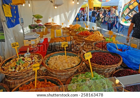 CERVIA, ITALY-SEPTEMBER 21, 2014: dry fruits  stand at the annual International food outdoor market. This market is very popular and attract thousands of tourists. - stock photo