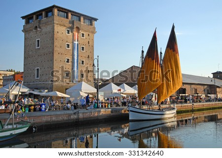 CERVIA, ITALY-SEPTEMBER 12, 2015: people crowd at the annual International  party of the salt. A lot of tourists and locals participate and receive a bag of local produced famous salt. - stock photo
