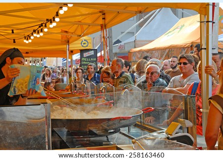 CERVIA, ITALY-SEPTEMBER 21, 2014: Spanish paiella stand at the annual International food outdoor market. This market is very popular and attract thousands of tourists. - stock photo