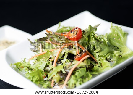 cesar salad on black background - stock photo