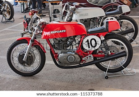 """CESENA, ITALY - OCTOBER 7: old italian racing motorcycle Ducati exposed at rally of vintage and modern motorbikes """"Motoconcentrazione della vendemmia"""" on october 7, 2012 in Cesena, Italy - stock photo"""