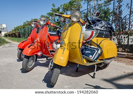 """CESENATICO, ITALY - MAY 5: vintage italian scooters Vespa  parked during the rally """"Raduno della Saraghina"""" on May 5, 2014 in Cesenatico, Italy  - stock photo"""