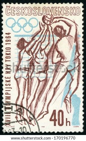 CESKOSLOVENSKO - CIRCA 1963: post stamp printed in Czech republic (Czechoslovakia) shows women playing volleyball, 1964 Olympic games Tokyo; sports series; Scott 1203 A463 40h brown blue, circa 1963 - stock photo